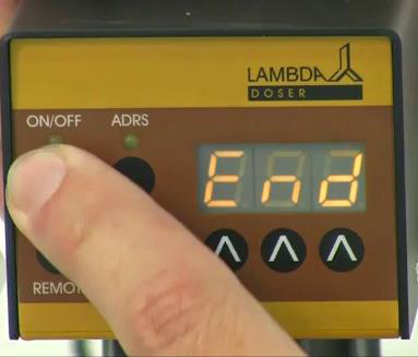 "Pressing the ON/OFF button again until the indication ""End"" appears on the display to confirm and save the program."
